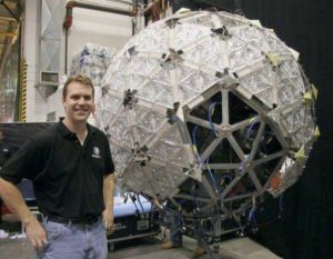 Photo of Chris next to the Waterford Crystal Times Square Ball